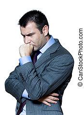 Portrait of a pensive worried businessman in studio on...