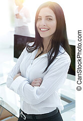 perspective successful young woman in the office