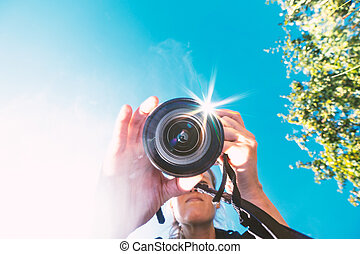 Portrait of a photographer with the camera
