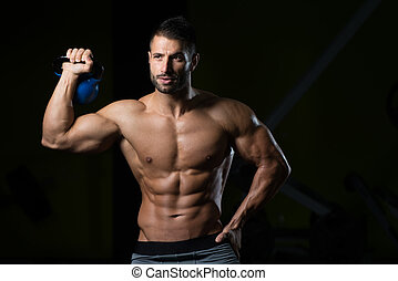 Portrait Of A Physically Fit Man With Kettle-bell