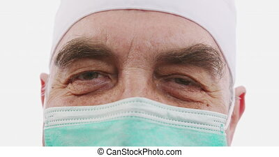 Portrait of a physician or surgeon. Concept: doctor, patient care, health and wellness in hospitals or private clinics