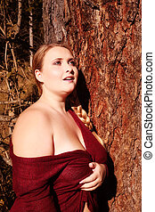 Portrait of a plump young woman with big breasts