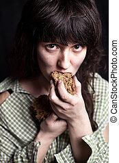beggar woman eating bread