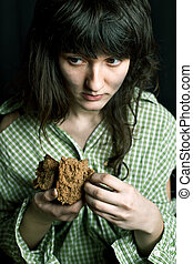 poor beggar woman with a piece of bread