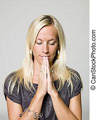 Portrait of a praying woman