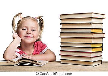 Portrait of a preschool child with books