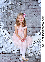 portrait of a pretty 8 year old girl in pink dress