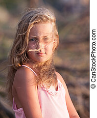 portrait of a pretty blond girl in the wind