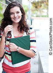 pretty college student on campus - portrait of a pretty...