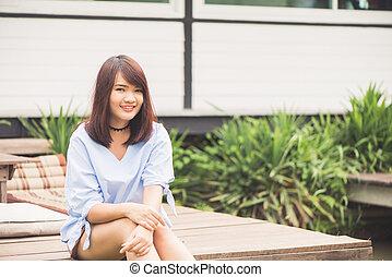 Portrait of a pretty happy woman, smiling
