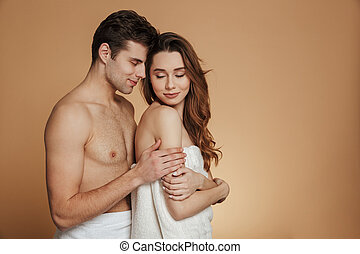 Portrait of a pretty loving shirtless couple embracing