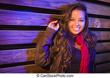 Mixed Race Young Adult Woman Against a Wood Wall Background