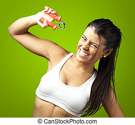 sporty woman - portrait of a pretty sporty woman over green ...
