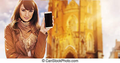 Portrait of a pretty woman holding a smartphone