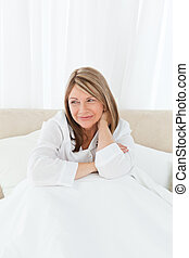 Portrait of a pretty woman on her bed