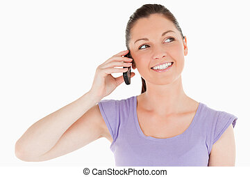 Portrait of a pretty woman on the phone while standing