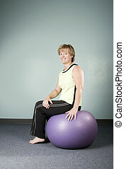 Woman Sitting on an Exercise Ball