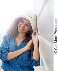 Portrait of a pretty woman smiling and posing with hat