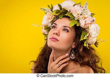 Portrait of a pretty woman wearing a wreath