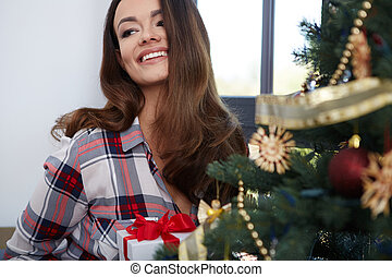 Portrait of a pretty woman with christmas tree.