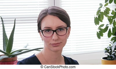 Portrait of a pretty young businesswoman looking at camera and smiling