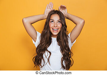 Portrait of a pretty young girl with long brunette hair
