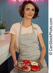 Portrait of a pretty young waitress in apron