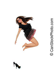 Portrait of a pretty young woman jumping in joy