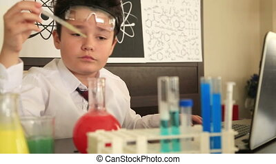 Portrait of a primary schoolboy in science lab - Cute...