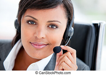 Portrait of a radiant customer service agent at work in the...