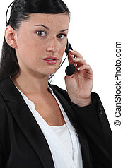 Portrait of a receptionist wearing a headset