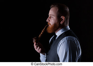 man smoking a pipe