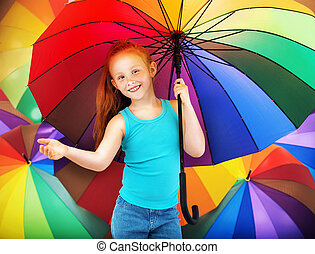Portrait of a redhead girl with an umbrella