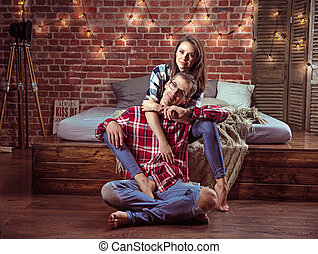 Portrait of a relaxed cheerful couple in a modern interior