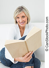Portrait of a relaxed woman reading book