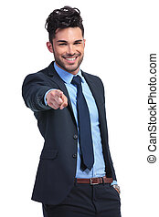 portrait of a relaxed young business man pointing