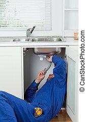 Portrait of a repairman fixing a sink