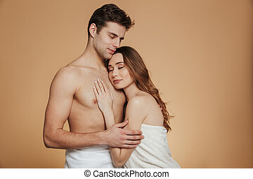 Portrait of a romantic loving shirtless couple embracing