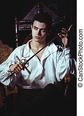 Portrait of a romantic man with a sword