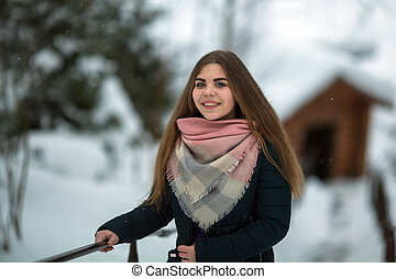 Portrait of a russian girl outdoors in winter.