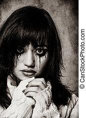 Portrait of a sad brunette girl.