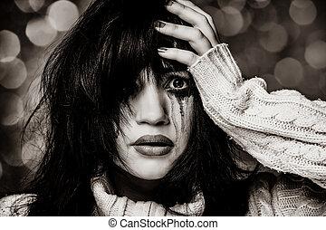 Portrait of a sad brunette.