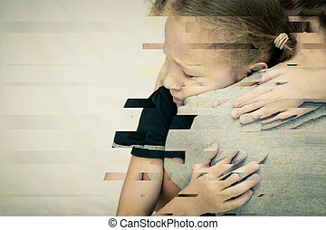 Portrait of a sad daughter hugging his mother.