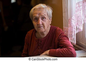 Portrait of a sad elderly woman.