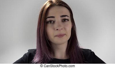 Portrait of a sad lady whith tears in her eyes on the white background
