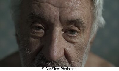 Portrait of a sad old man - Old poor man at home look at the...