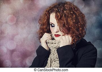 Portrait of a sad redhead.