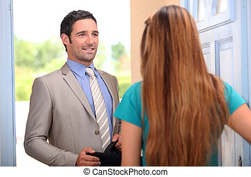 portrait of a salesman with client