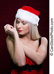 Portrait of a santa girl with closed eyes.