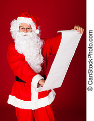 Portrait of a santa holding paper scroll